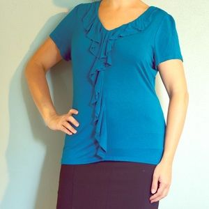 Blue top with ruffles in the middle